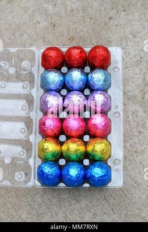 Colourful Chocolate Eggs on plastic carton - Stock Photo