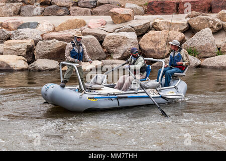 Professional guide & clients fly fishing from a boat on the Arkansas River, Salida, Colorado, USA - Stock Photo