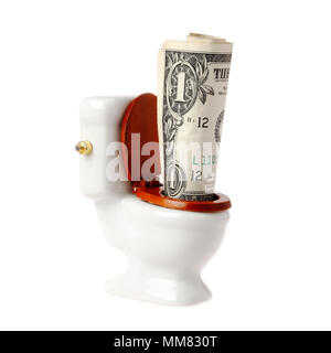 One US dollar banknote in a miniature toilet, isolated on white background. - Stock Photo