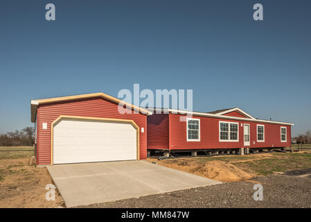 New manufactured home and stick built garage need finishing before owners can move in - Stock Photo