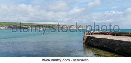 View of the jetty and across the bay to Ballard Down, Swanage, Dorset, England, Britain - Stock Photo