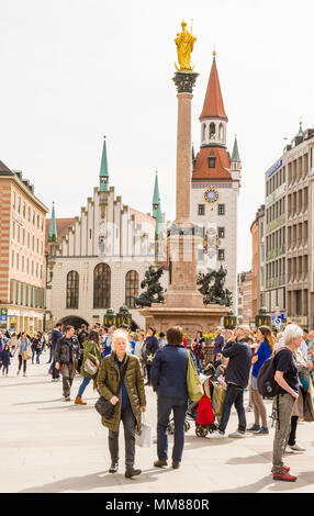 MUNICH, GERMANY - APRIL 4: Tourists at the Marienplatz square in Munich, Germany on April 4, 2018. - Stock Photo