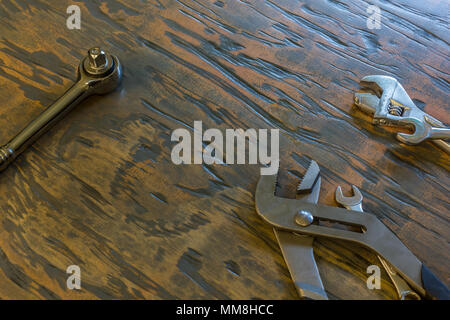 wrenches and tolls on wood board - Stock Photo