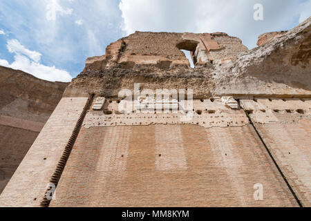 Wide angle picture of old huge walls of Baths of Caracalla, important landmark from Roman Empire located in Rome, Italy - Stock Photo