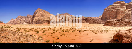 Composite panorama of high resolution aerial photos of a monolithic mountain in the central area of the desert reserve of Wadi Rum, Jordan, middle eas - Stock Photo
