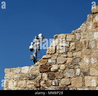 Modern video surveillance system on the old walls of the crusader fortress of Karak, Jordan, middle east - Stock Photo