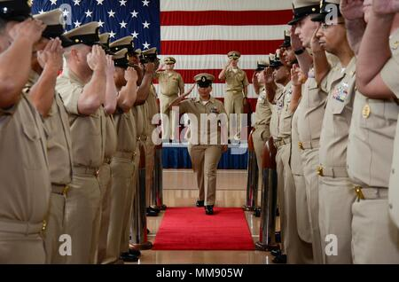 PORTLAND, Ore. (Sept. 16, 2017) Newly frocked Chief Ship's Serviceman Joann Maldonado, assigned to the submarine tender USS Frank Cable (AS 40), salutes sideboys during a chief petty officer pinning ceremony at the Navy Operational Support Center in Portland, Ore., Sept. 16. Frank Cable, currently in Portland or a scheduled dry-dock phase maintenance availability, conducts maintenance and support of submarines and surface vessels in the Indo-Asia-Pacific region. (U.S. Navy photo by Mass Communication Specialist Seaman Heather C. Wamsley/Released) - Stock Photo