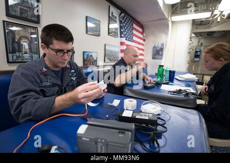 170912-N-WV703-0059 ATLANTIC OCEAN (Sept. 12, 2017) Electrician's Mate 1st Class Nicholas Salutare, from Pine Bush, New York, left, and Electrician's Mate 2nd Class Matthew Holland, from Noris Town, Pennsylvania, conduct safety checks and tagging of electrical equipment for Sailors aboard the Arleigh Burke-class guided-missile destroyer USS Winston S. Churchill (DDG 81) Sept. 12, 2017. Winston S. Churchill, homeported at Naval Station Norfolk, is conducting naval operations in the U.S. 6th Fleet area of operations in support of U.S. national security interests in Europe. (U.S. Navy photo by Ma - Stock Photo