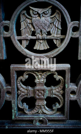 An owl and a filigree that are part of decorative ornamentation on a building - Stock Photo