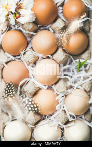 Natural colored eggs for Easter in box, close-up - Stock Photo