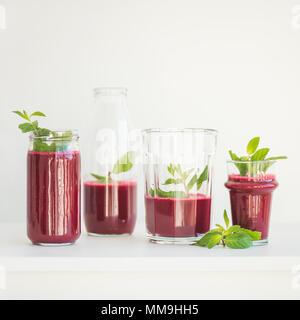 Fresh morning beetroot smoothie or juice in glasses, square crop - Stock Photo