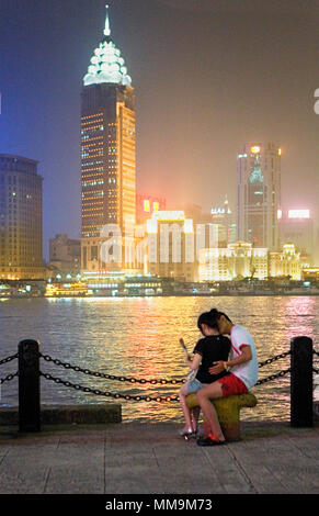 China.Shanghai: Couple.The city from Pudong. - Stock Photo