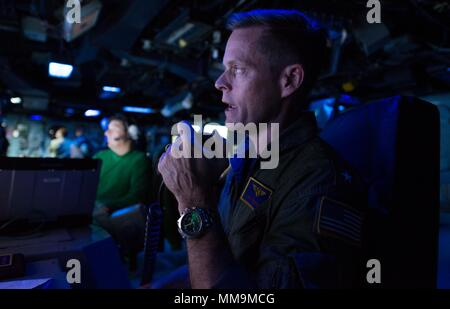 170919-N-BD308-0031 Caribbean Sea (Sept. 19, 2017) Commander, Expeditionary Strike Group 2, Rear Admiral Jeffrey Hughes addresses the crew of the amphibious assault ship USS Wasp (LHD 1). Wasp is currently assisting residents of the Caribbean Islands in the wake of Hurricane Irma, and is also preparing to assist once Hurricane Maria makes landfall. (U.S. Navy photo by Mass Communications Specialist 3rd Class Levingston Lewis/Released) - Stock Photo