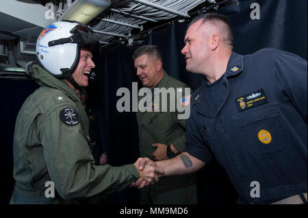 170919-N-BD308-0020  CARIBBEAN SEA (Sept. 19, 2017)  Rear Adm. Jeffrey Hughes, left, commander of Expeditionary Strike Group 2, meets Command Master Chief Gregory Carlson, command master chief of the amphibious assault ship USS Wasp (LHD 1). Wasp is assisting residents of the Caribbean Islands in the wake of Hurricane Irma, and is also preparing to assist once Hurricane Maria makes landfall. (U.S. Navy photo by Mass Communications Specialist 3rd Class Levingston Lewis/Released) - Stock Photo
