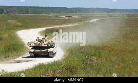 Marines operate an M1A1 Abrams tank during a gunnery range at Camp Lejeune, N.C., Sept. 19, 2017. The semi-annual range consists of multiple firing tables and a final qualification. The Marines are with 2nd Tank Battalion, 2nd Marine Division. (U.S. Marine Corps photo by Lance Cpl. Holly Pernell) - Stock Photo