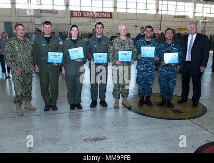 PANAMA CITY, Florida - Naval Surface Warfare Center Panama City Division (NSWC PCD) Aviation Sailors receive Certificates of Appreciation for their selection and participation in the 2017 Advanced Naval Technology Exercise, ANTX, Battlespace Preparation in a Contested Environment Sept. 22, 2017. From left to right: NSWC PCD Commanding Officer Capt. Aaron Peters, Lt. Elizabeth Janca, Naval Air Crewman First Class Petty Officer Harrison Greenmaki, Senior Chief Mineman Bryan Littrell, Logistics Specialist First Class Petty Officer Michael Semler, Logistics Specialist First Class Petty Officer Rob - Stock Photo
