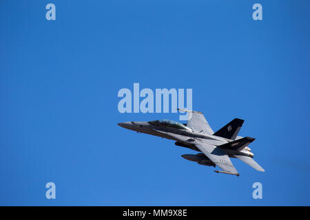 A U.S Marine Corps F/A-18D Hornet attached to Marine Aviation Weapons and Tactics Squadron One (MAWTS-1) fly by after engaging a target in support of Weapons Tactics Instructors course (WTI) 1-18 at Chocolate Mountain Aerial Gunnery Range, Calif., Sept. 22, 2017. WTI is a seven-week training even hosted by MAWTS-1 cadre, which emphasizes operational integration of the six functions of Marine Corps aviation in support of a Marine Air Ground Task Force and provides standardized advance tactical training and certification of unit instructor qualifications to support Marine aviation Training and R - Stock Photo