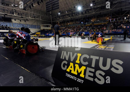 Team U.S. plays against Team Ontario in wheelchair rugby during the 2017 Invictus Games at the Mattamy Athlethics Centre in Toronto, Canada, September 27, 2017. The Invictus Games are the sole international adaptive sporting event for injured active duty and veteran service members. (U.S. Air Force photo/ Staff Sgt. Jannelle McRae)
