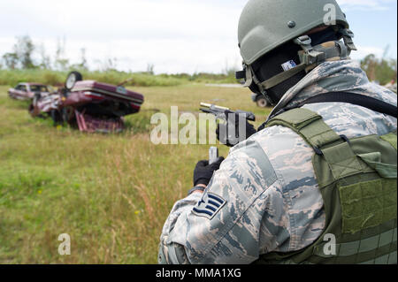 Reserve Citizen Airmen from the 482nd Security Force Squadron, Homestead Air Reserve Base, Florida, participate in a shoot, move, and communicate training with sim-munitions on September 26, 2017.  This annual training for security forces members helps keep the airmen proficient in many situation they may encounter stateside or overseas. - Stock Photo