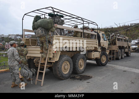 Army National Guard Soldiers assigned to the 1st Battalion, 65th Infantry Regiment board a Light Medium Tactical Vehicle outside the Leonard B. Francis Armory in St. Thomas, Sept, 26, 2017. More than 300 members of the Puerto Rico Army National Guard departed St. Thomas after assisting with hurricane recovery efforts in the U.S. Virgin Islands. The Soldiers helped to establish and manage food and supplies distribution points throughout the islands, maintained multiple security checkpoints and performed high volume water purification. - Stock Photo