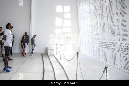 PEARL HARBOR (Sept. 27, 2017) DeAndre Jordan, basketball player for the Los Angeles Clippers reads over the names on the USS Arizona BB-39 Casualty List in the shrine room on the USS Arizona Memorial, Sept. 27. While on Oahu for their pre-season training camp, the entire LA Clippers basketball team, coaches, and staff took part in a tour of the USS Arizona Memorial. Along with the team, service members from all branches of the military met at Merry Point Landing, located on Joint Base Pearl Harbor-Hickam, to board a vessel which took them to the memorial. (U.S. Navy photo by Mass Communication - Stock Photo