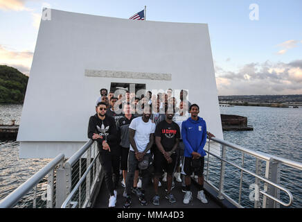 PEARL HARBOR (Sept. 27, 2017) Players from the Los Angeles Clippers basketball team take a group photo on the USS Arizona Memorial, Sept. 27.  While on Oahu for their pre-season training camp, the entire LA Clippers basketball team, coaches, and staff took part in a tour of the USS Arizona Memorial. Along with the team, service members from all branches of the military met at Merry Point Landing, located on Joint Base Pearl Harbor-Hickam, to board a vessel which took them to the memorial. (U.S. Navy photo by Mass Communication Specialist 1st Class  Meranda Keller) - Stock Photo