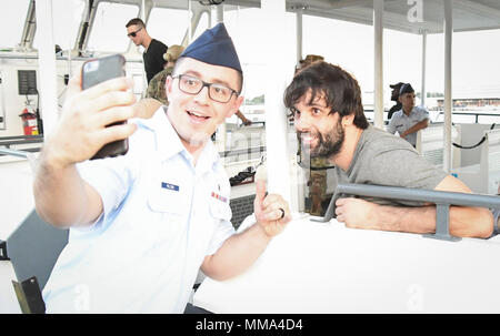 PEARL HARBOR (Sept. 27, 2017) Miloš Teodosić, basketball player for the Los Angeles Clippers pauses for a photo with a  Joint Base Pearl Harbor-Hickam (JBPHH) Service Member, Sept. 27. While on Oahu for their pre-season training camp, the entire LA Clippers basketball team, coaches, and staff took part in a tour of the USS Arizona Memorial. Along with the team, service members from all branches of the military met at Merry Point Landing, located on JBPHH, to board a vessel which took them to the memorial. (U.S. Navy photo by Mass Communication Specialist 1st Class  Meranda Keller) - Stock Photo