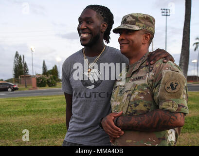 PEARL HARBOR (Sept. 27, 2017) Patrick Beverley, basketball player for the Los Angeles Clippers pauses for a photo with a Joint Base Pearl Harbor-Hickam (JBPHH) Service Member, Sept. 27.  While on Oahu for their pre-season training camp, the entire LA Clippers basketball team, coaches, and staff took part in a tour of the USS Arizona Memorial. Along with the team, service members from all branches of the military met at Merry Point Landing, located on JBPHH, to board a vessel which took them to the memorial. (U.S. Navy photo by Mass Communication Specialist 1st Class  Meranda Keller) - Stock Photo