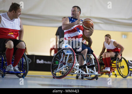 U.S. Army veteran Sean Hook attends the Wheelchair Basketball event during the Invictus Games at the Air Canada Centre (ACC), Toronto, Canada, Sept. 28, 2017. Invictus Games, September 23-30, is an international Paralympic-style, multi-sport event, created by Prince Harry of Wales, in which wounded, injured or sick armed services personnel and their associated veterans take part in sports including wheelchair basketball, wheelchair rugby, sitting vollyball, archery, cycling, wheelchair tennis, powerlifting, golf, swimming, and indoor rowing. (U.S. Army photo by Pfc. Seara Marcsis) - Stock Photo