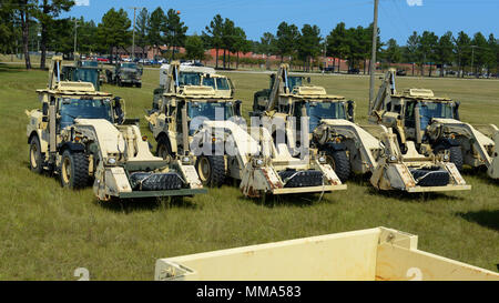 U.S. Soldiers assigned to the 178th Engineer Battalion, South Carolina Army National Guard, stage heavy equipment for transport to Puerto Rico at McEntire Joint National Guard Base. S.C. Sept. 29, 2017.  Engineers from South Carolina are being sent to help Puerto Rico with recovery efforts after Hurricane Maria devastated the island.  (U.S. Air National Guard photo by Tech. Sgt. Jorge Intriago) - Stock Photo