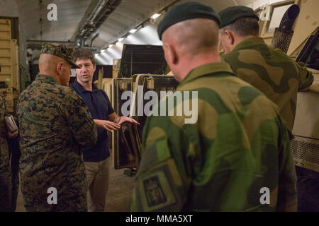 Commandant of the Marine Corps Gen. Robert B. Neller, left, tours facilities in Frigård, Norway, Sept. 29, 2017. Neller visited Norway to strengthen the military-to-military relationship between the two countries. (U.S. Marine Corps photo by Cpl. Samantha K. Braun) - Stock Photo