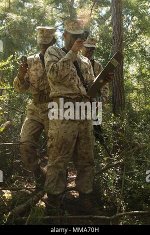 U.S. Marine Corps Recruits with Delta Company, 1st Battalion, Recruit Training Regiment, use compass techniques to reach their next plot point at Elliot's Beach on Marine Corps Recruit Depot, Parris Island, S.C., Sept. 25, 2017.  The Land Navigation Course teaches recruits how to properly navigate unfamiliar terrain.  (U.S. Marine Corps photo by Lance Cpl. Yamil Casarreal/Released) - Stock Photo