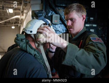 170929-N-VK310-0029 CARIBBEAN SEA (Sept. 29, 2017) Naval Aircrewman (Helicopter) 2nd Class Brandon Larnard, assigned to Helicopter Sea Combat Squadron 22 (HSC-22), assists Thierry Rolle, a resident of French Guadalupe, prior to departing the amphibious assault ship USS Wasp (LHD 1) en route to the island of Guadalupe. Rolle and another passenger were rescued by HSC-22 personnel after their private aircraft crashed into the water off the coast of Dominica on Sept. 28. Wasp is currently participating in humanitarian relief efforts in the Caribbean Sea following the landfall of Hurricane Maria. T - Stock Photo