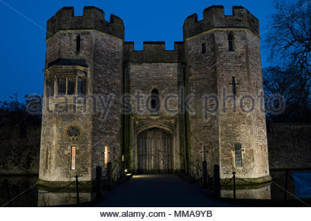 Evening view of the gatehouse to the Bishop's Palace, Wells, Somerset, England, UK - Stock Photo