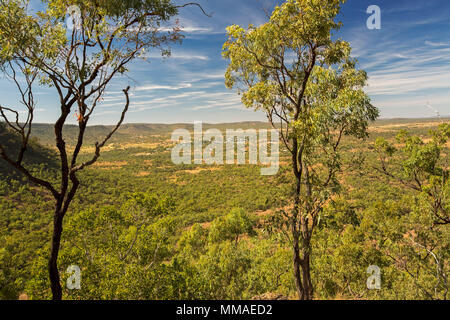 View of vast outback landscape of ranges and plains under blue sky from lookout at Minerva Hills National Park, near Springsure Queensland Australia - Stock Photo