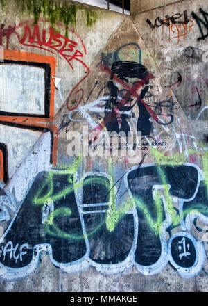Berlin Mitte. Street art and graffiti under S-bahn railway bridge across Spree River. - Stock Photo