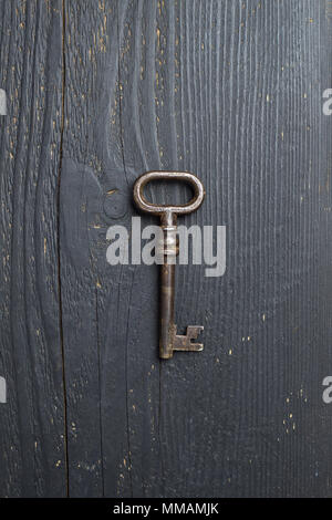 Vintage Key over dark wooden table, top view - Stock Photo
