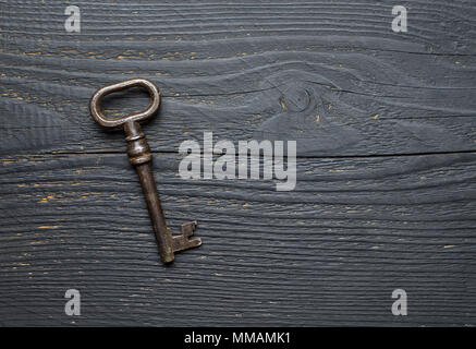 Vintage Key over dark wooden table, top view with negative space - Stock Photo