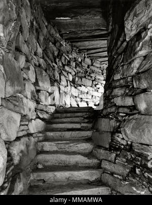 View SE of flat lintel slabs & ascending stairway between the inner (R) & outer (L) walls of Dun Troddan Iron Age broch tower, Glenelg, Scotland, UK. - Stock Photo