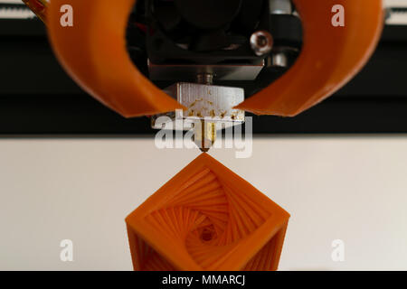 3d printer hot-end nozzle with printed object concept - Stock Photo