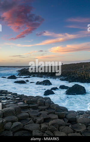 Sunset over the Giant's Causeway, County Antrim, Northern Ireland - Stock Photo