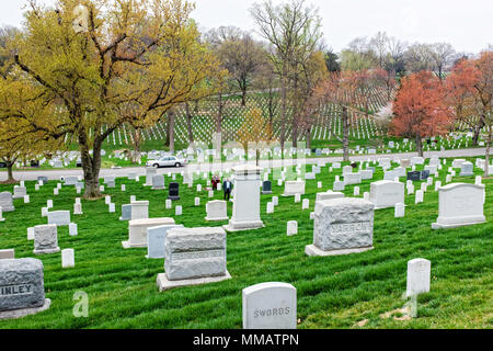 Row upon row of grave markers in the spring at Arlington National Cemetery - Stock Photo