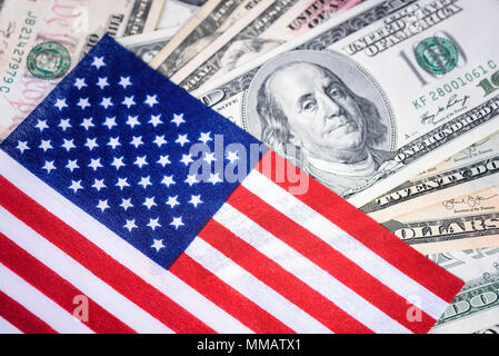 American flag on hundred dollar bill background. Money, cash background. Financial concept. - Stock Photo