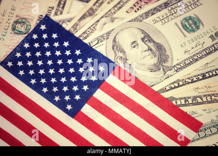 American flag on hundred dollar bill background. Money, cash background. Financial concept. Vintage, retro look. - Stock Photo