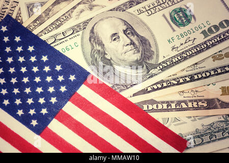 American flag on hundred dollar bill background. Vintage, retro look. Money, cash background. Financial concept. - Stock Photo