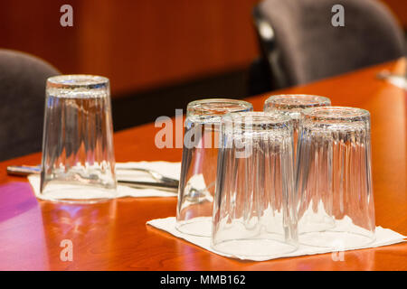 clean emty glasses standing on the table ready to be used in the restourant - Stock Photo