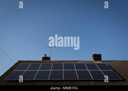 Solar panels on the roof of a rural bungalow, on 5th May 2018, in Wrington, North Somerset, England. - Stock Photo