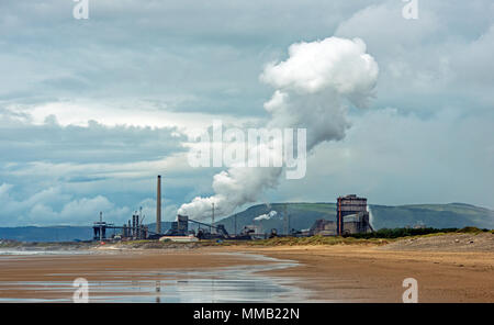 TATA Steelworks in Port Talbot, seen form the Kenfig Beach, south Wales - Stock Photo
