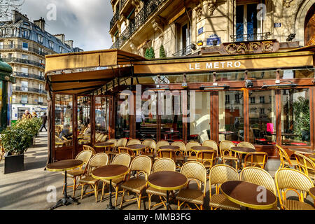 Tables and chairs outside Le Metro  Café and restaurant  on Boulevard Saint-Germain , Paris ,France - Stock Photo
