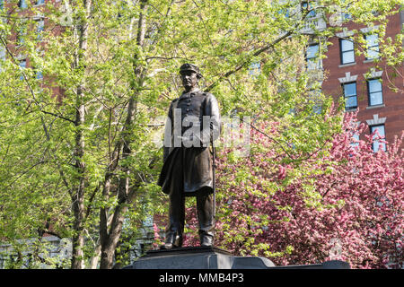 Farragut Monument is surrounded by beautiful spring trees in Madison Square Park, NYC, USA - Stock Photo